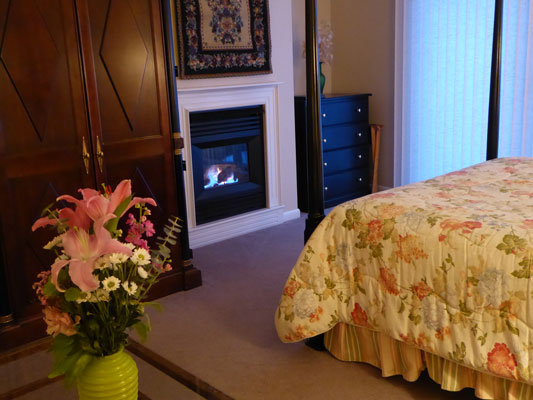 Fireplace at the foot of the bed in Room 7
