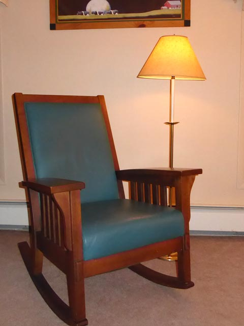 Teal leather rocking chair in Room 1